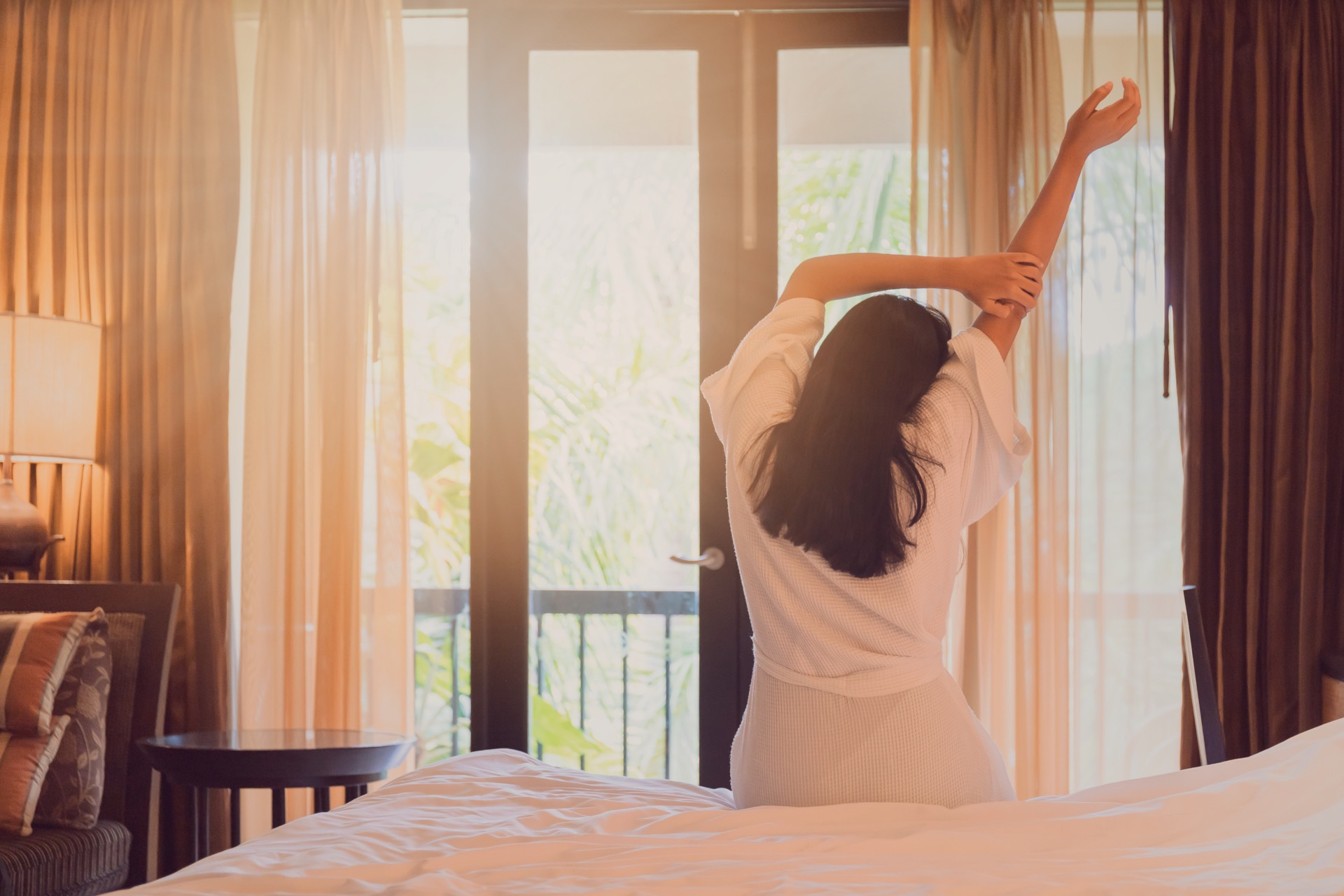 Asian Women Are Staying In A Hotel Room After Wake Up On Morning