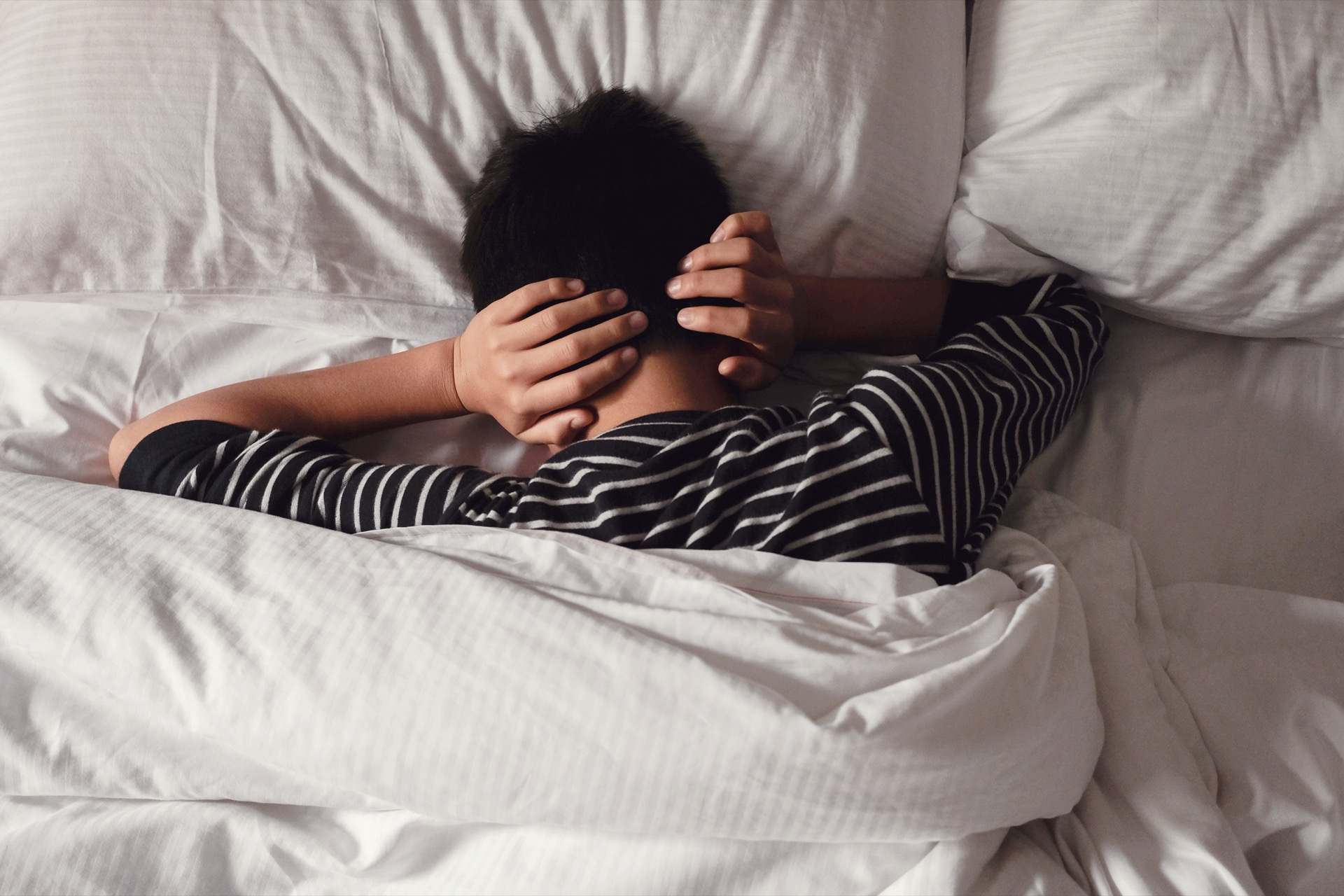 Preteen Tween Boy Covering Ears With His Hands In Bed, Adhd, Sle