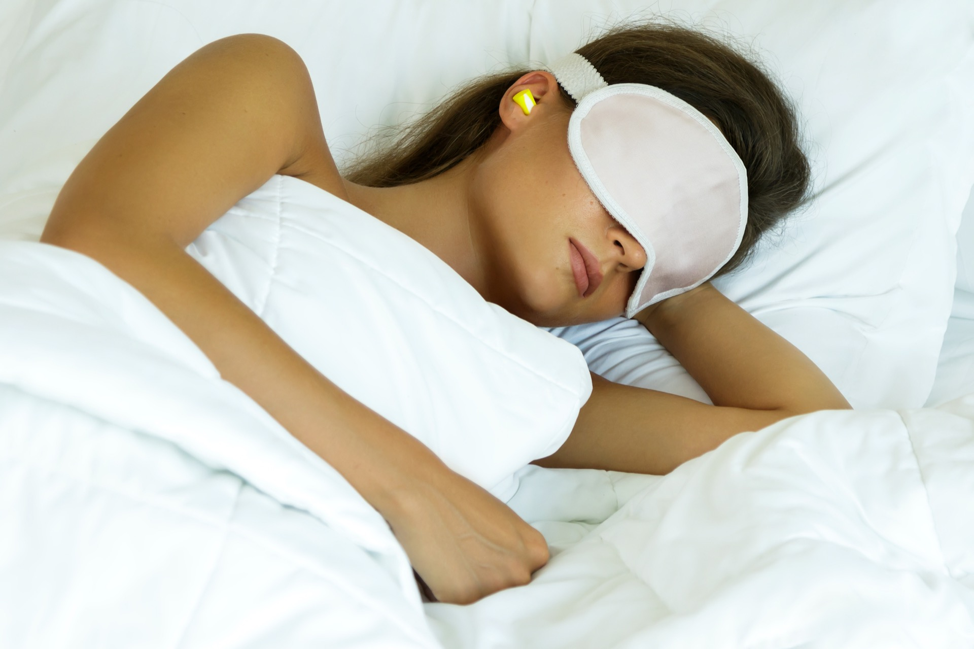 Woman Is Wearing Eye Mask And Using Earplugs